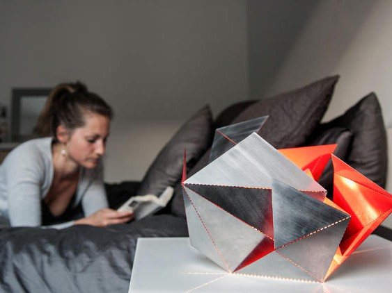 3052128-slide-s-6-the-folding-lamp-makes-origami-out-of-light copy